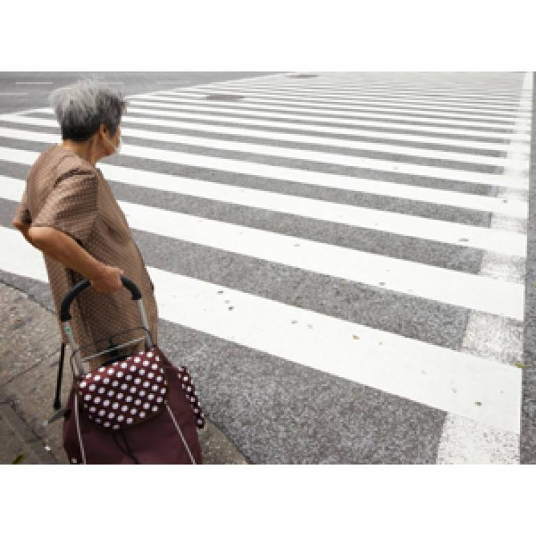 Older person crossing the road