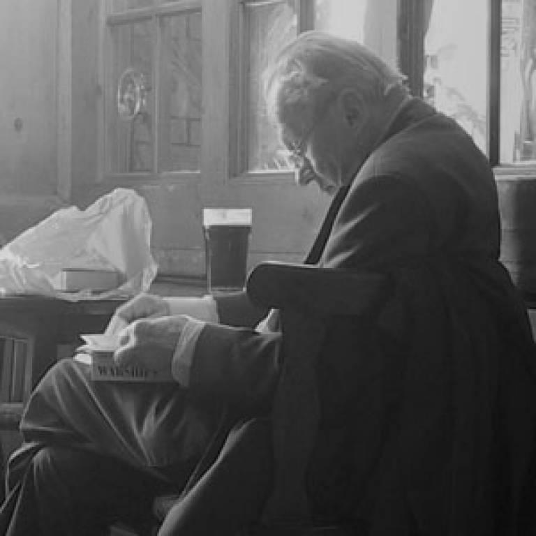 Old man drinking in pub