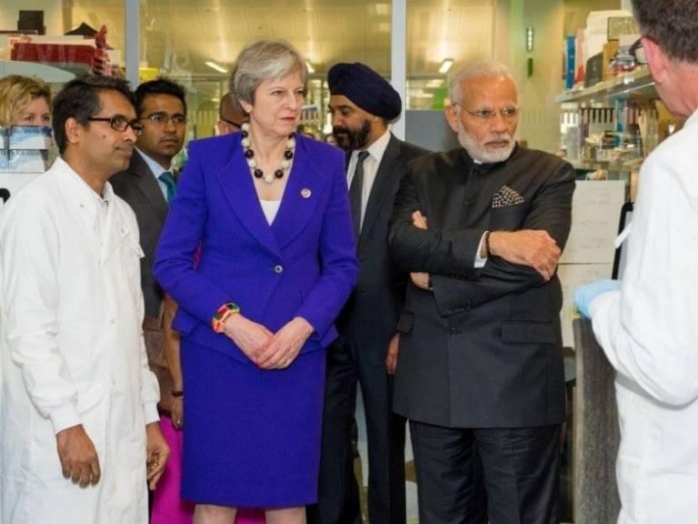 Raju Veeriah (left) with Theresa May and Nahendra Modi