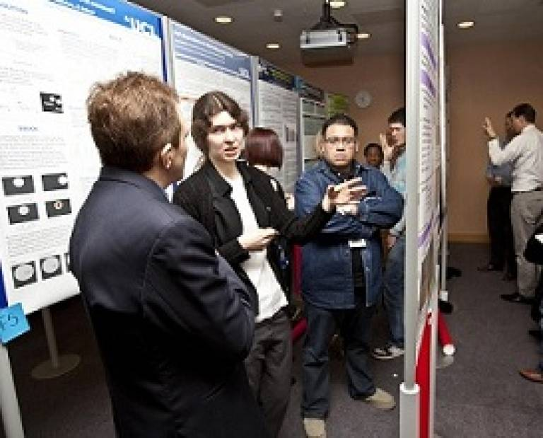 PhD student, Anna Benedykcinska presents her poster to one of the judges