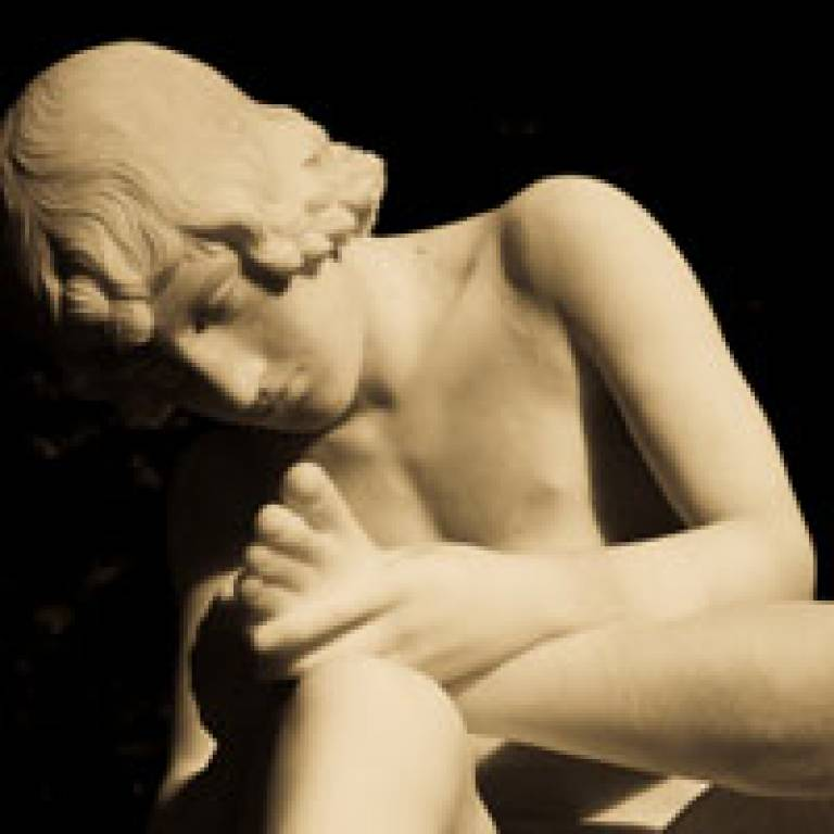 Marble statue of Achilles taking a closer look at his injured heel