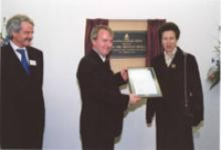 Mr William Wilson (centre), Director of Student Residences, receiving the Hospitality Assured accreditation from The Princess Royal, in the presence of UCL's Provost & President, Professor Malcolm Grant