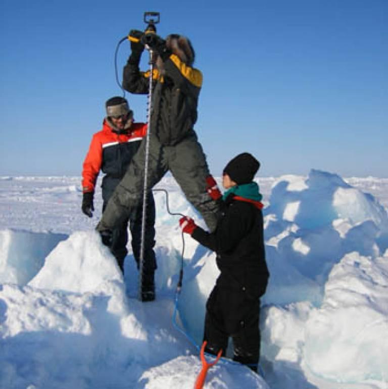Drilling a ridge in the Arctic snow
