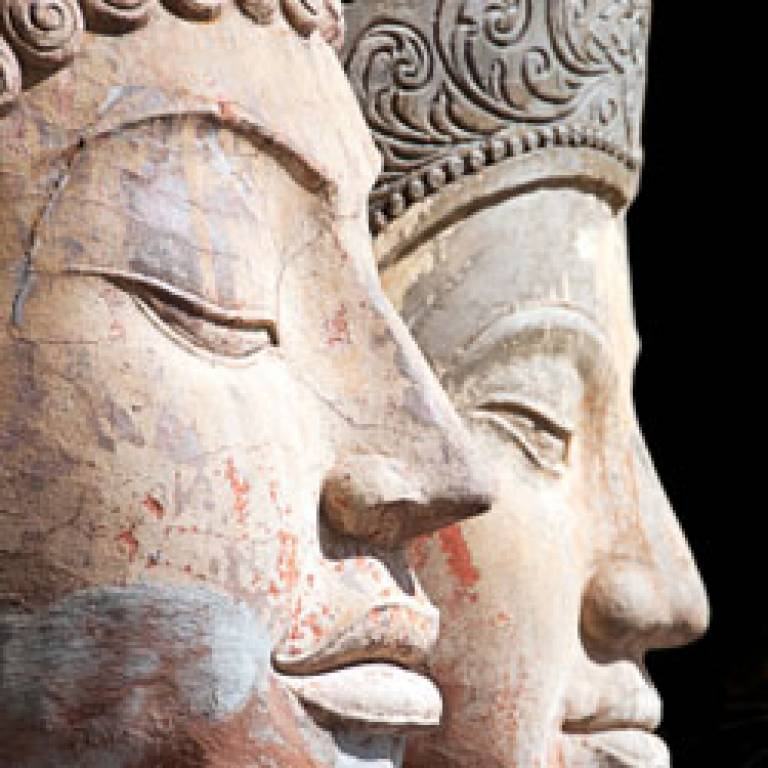 Two buddha heads