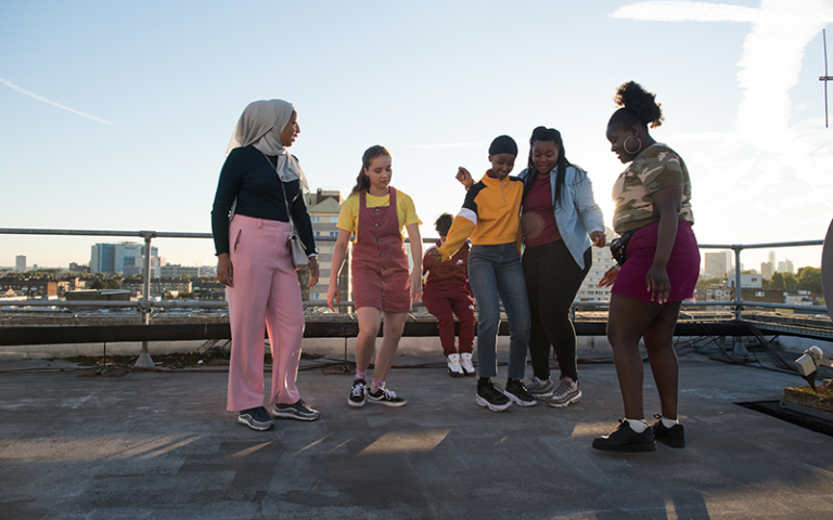Still from the series Rocks with teenage girls hanging out together