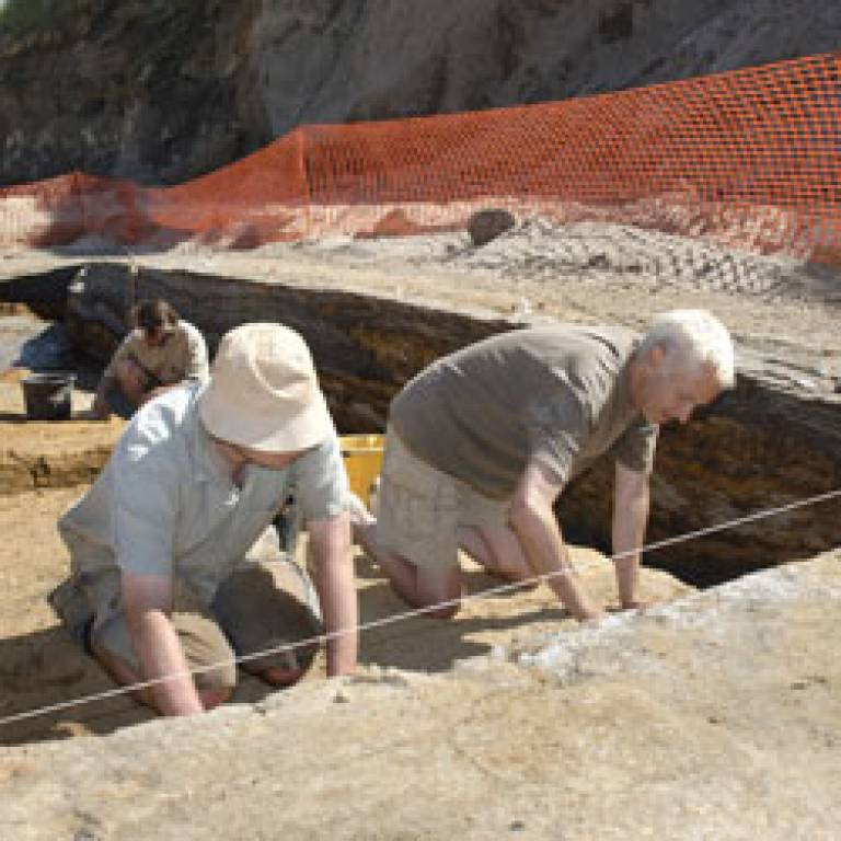 Archaeologists excavating the gravel bar close to the edge of the course of the ancient River Thames