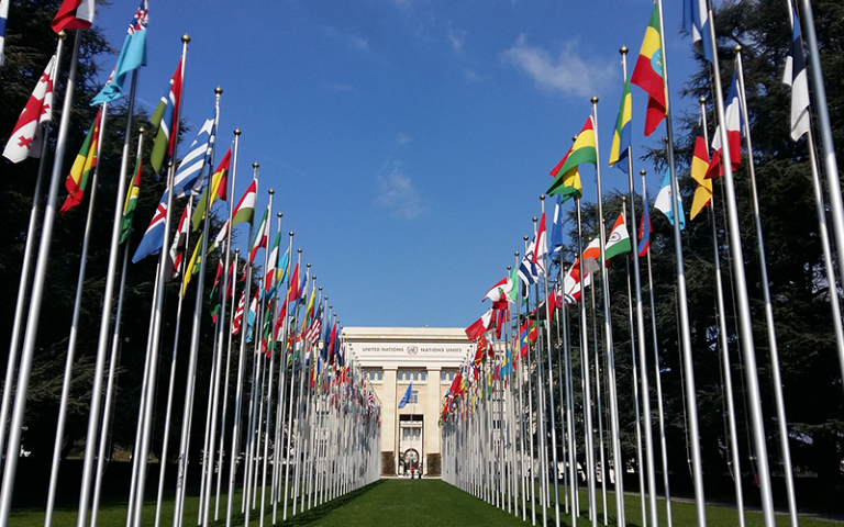 An image of flags outside UN HQ in Geneva