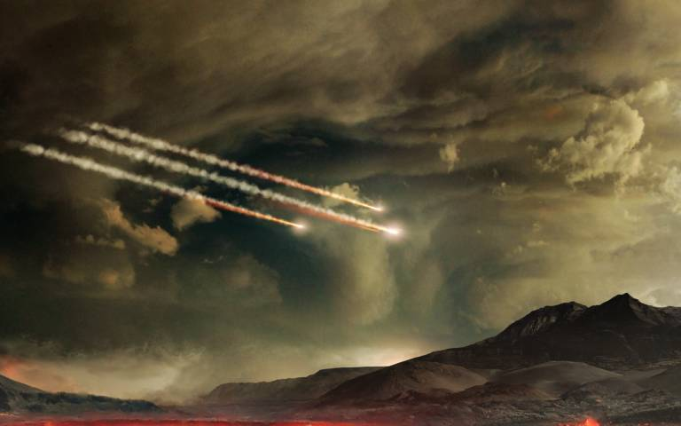 an artist's conception of early Earth being hit by asteroids