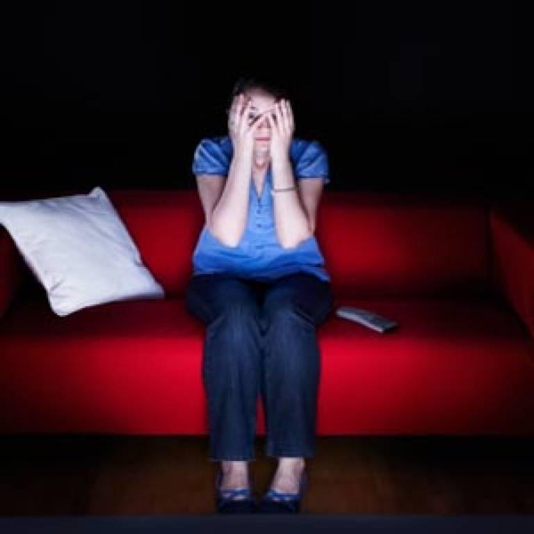 Woman watching horror film