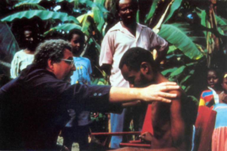 Professor Littlewood during field research clinically examines a 'zombi' in Haiti