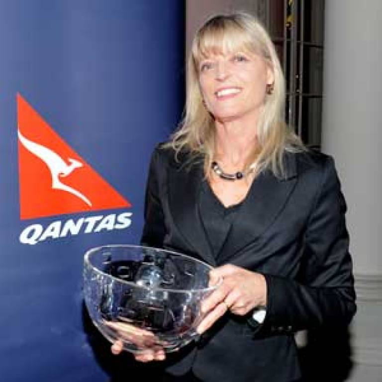 Dr Margaret Mayston with her award from Quantas