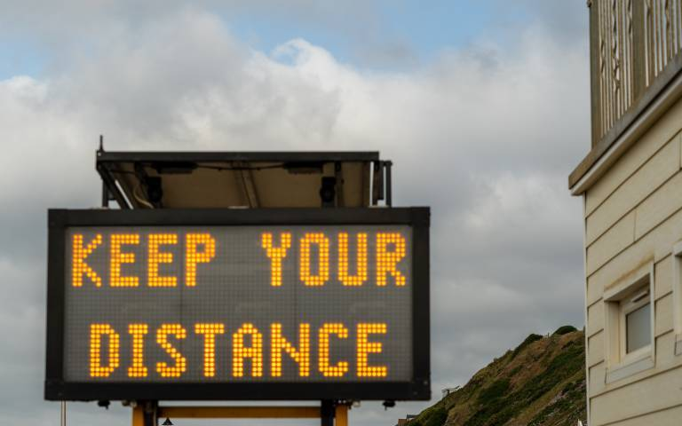 """Large sign saying """"keep your distance"""""""
