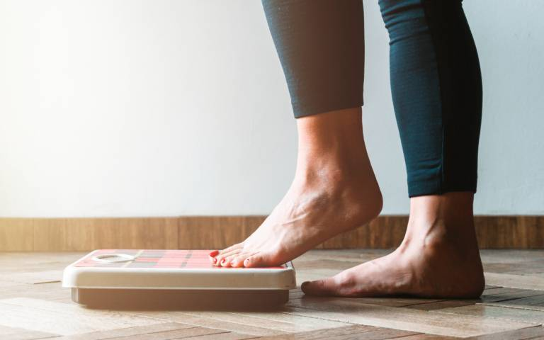 person stepping on scales