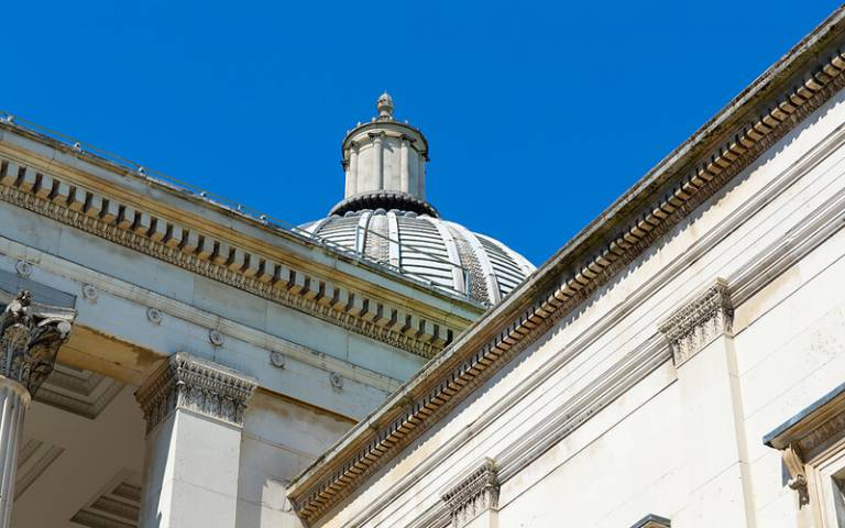 A view of the Wilkins Building and Portico, with blue sky