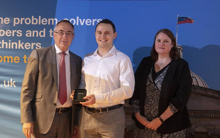 Photo of Maksims Ivkins receiving his Professional Services Award