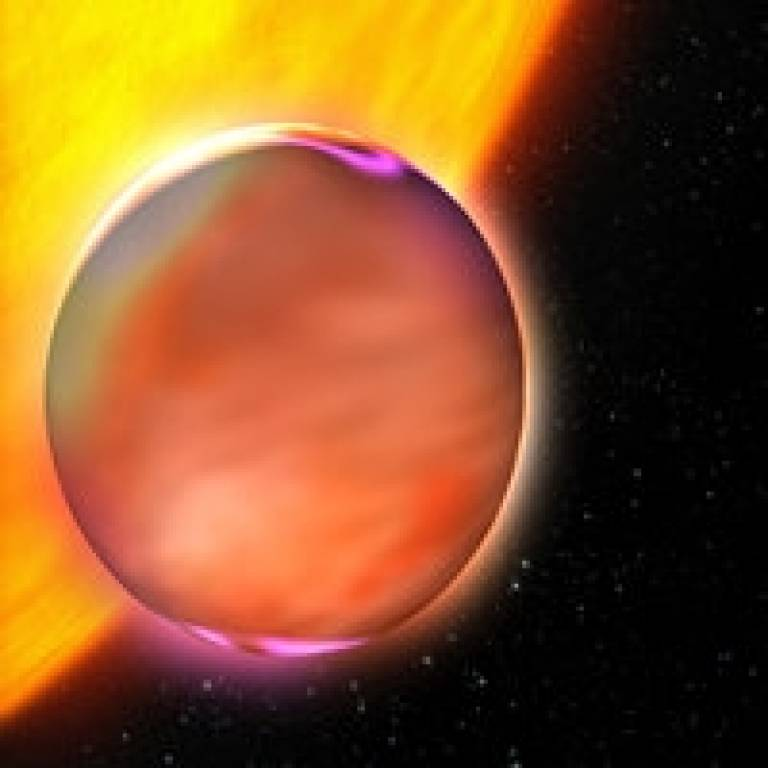 Extrasolar planet HD189733b rises from behind its star. Is there methane on this planet? (Credit: ESA)