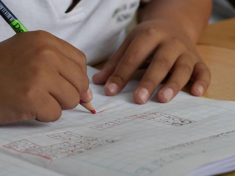 school pupil writing