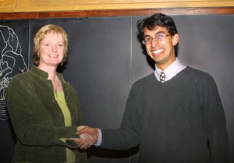 Dr Arjun Sen receiving first prize for his poster