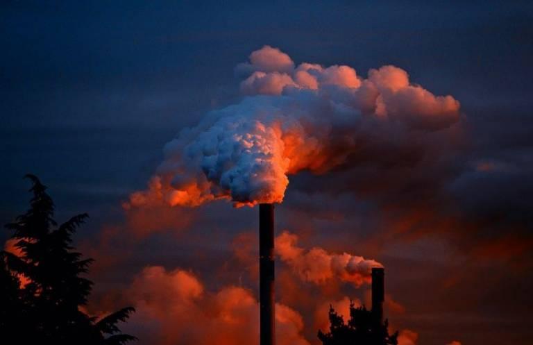 Power stations emitting smoke at sunset