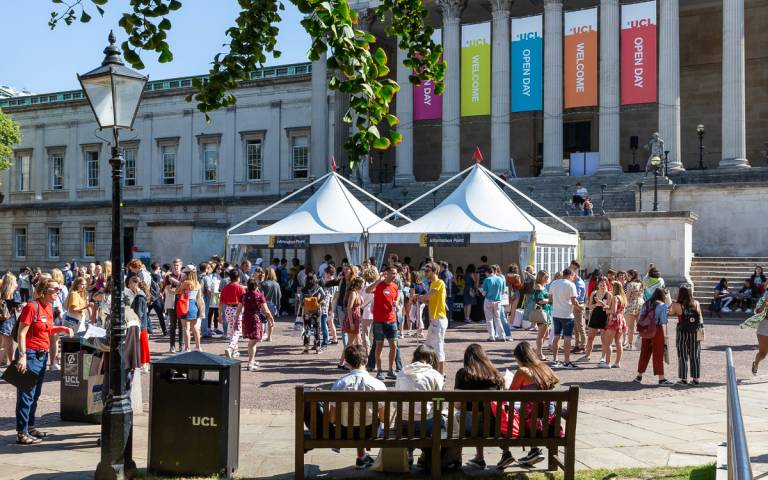 Visitors talking in the quad at a UCL open day