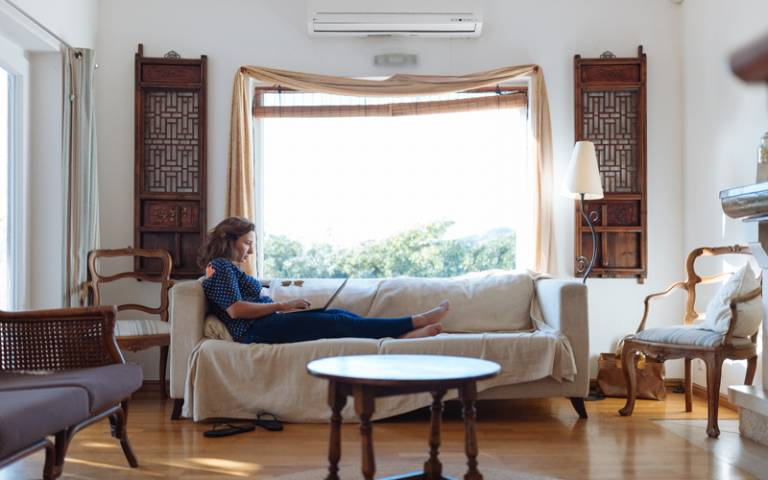 A woman sitting on sofa in living room