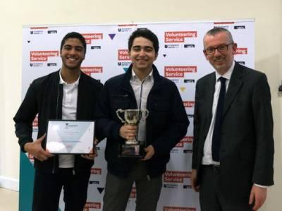 Mohamed winning his Volunteering Award