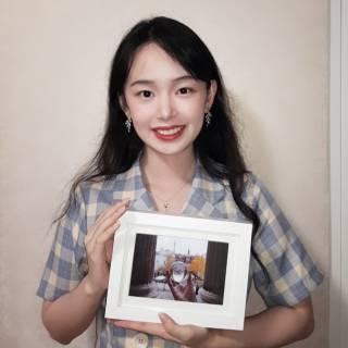#loveUCL 2019-20 Photo of the Year winner, Bartlett graduate Runsu holding her winning photo