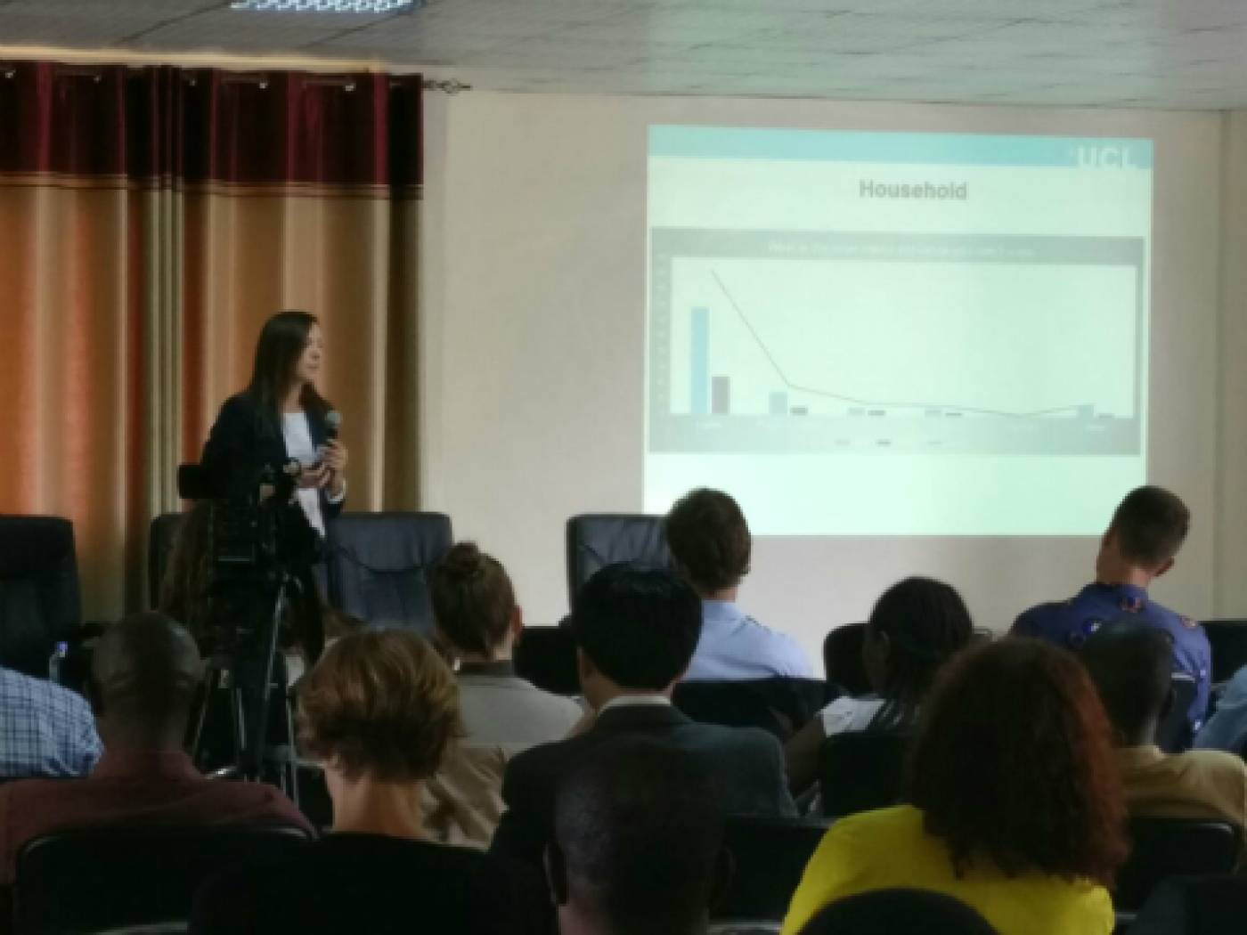 UCL USAR PhD student Iwona Bisaga presenting initial findings of her research focusing on SHS users in Rwanda.