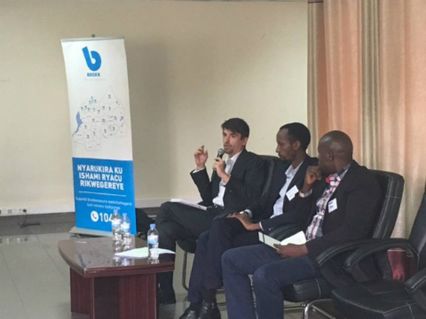 Simon Rolland (EnDev), Justus Mucyo (BBOXX) and Morris Kayitare (EDCL), answer questions from the audience.