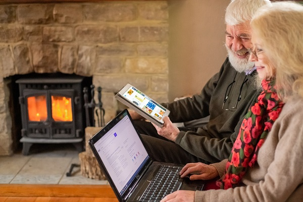 Picture of two older people in front of laptops