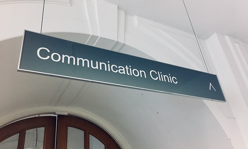 sign directing to communication clinic