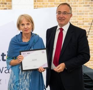 Rachel Rees receiving Education Award