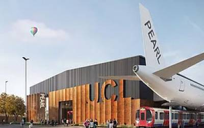 An aircraft with PEARL written on the tail outside of a building with UCL on it