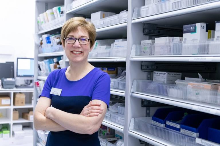 Prof Bryony Dean Franklin standing in front of shelves filled with pharmaceutical products