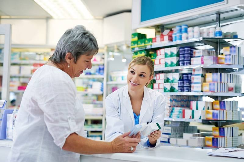 Pharmacist and patient discussing medicines