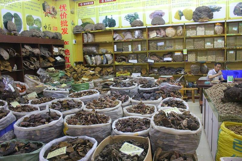 The spice market at Kunming in China. There are samples stored in tubs in a shop.