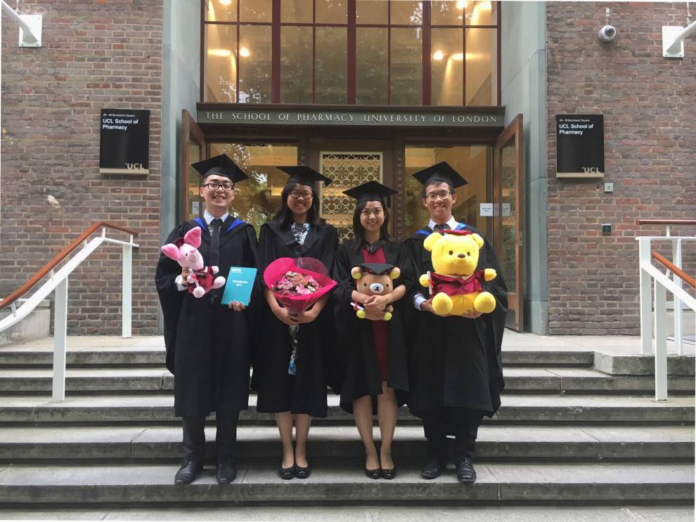 Graduates standing at the entrance of the UCL School of Pharmacy