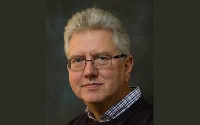 Prof Andrew Coates