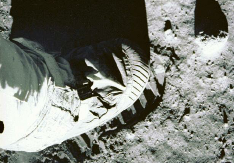 Close-up of the lunar regolith with astronaut's boot for scale (credit: NASA)