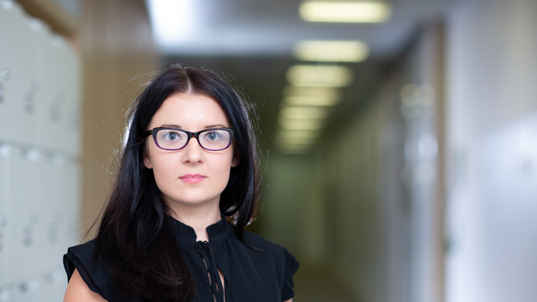 Woman in Black Wearing Glasses