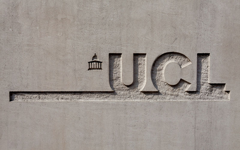 A carving of UCL's logo
