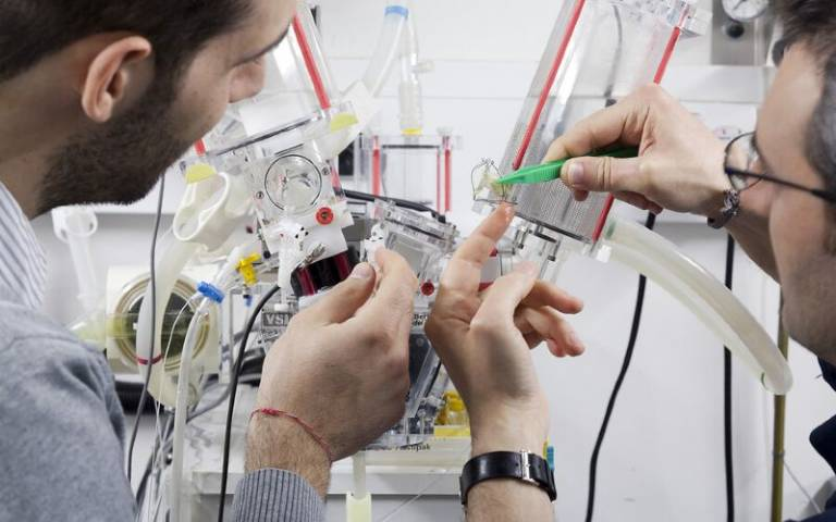Two researchers work on circuit
