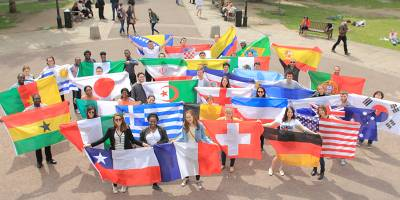 International students with flags in the UCL Quad