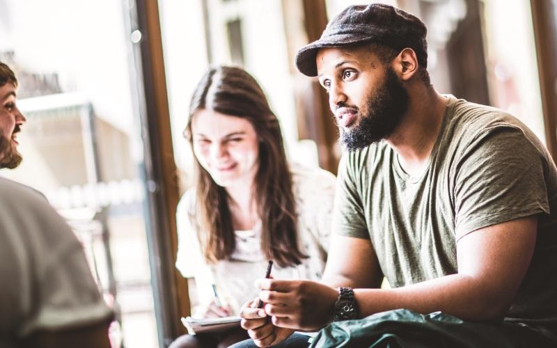 Graduate students in coffee bar