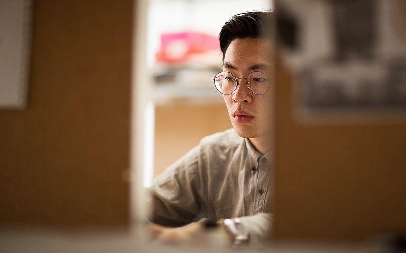 Student works at desk