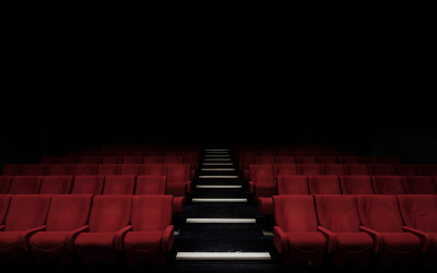 Red cinema seats viewed from the front.
