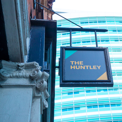The hanging sign of The Huntley student pub.