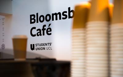 Logo sign behind coffee bar in Bloomsbury Cafe.