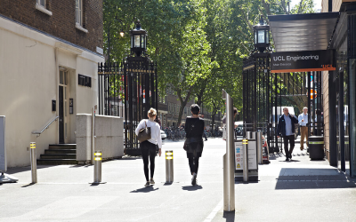 People walk in the street outside the UCL Engineering Faculty.