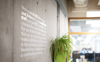 Innovation and office mural, writing describes values of the team and deparment.